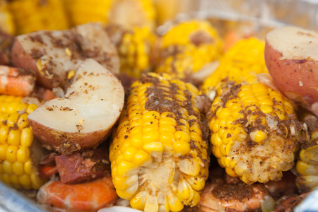 shrimp: A traditional low country boil with red potatoes, corn on the cob, and shrimp.  Everything is seasoned to perfection with cajun spices.