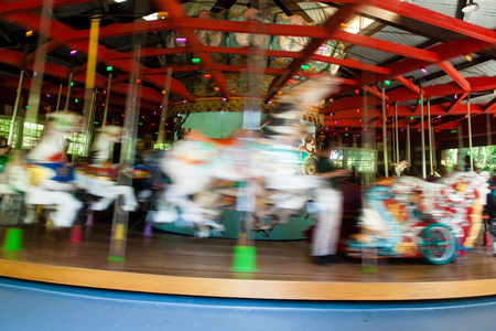 Movement is seen in a carousel horse 免版税图像