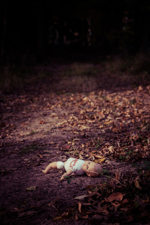 woodland  horror: Creepy doll abandoned in woods