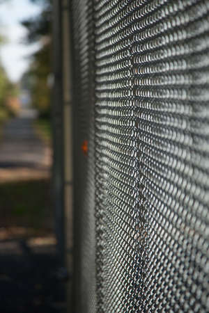 chain link fence: Chain link fence; vertical image