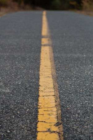 low perspective: Road Closeup with Yellow Line