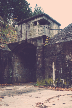 Decaying structure at military base; vertical image