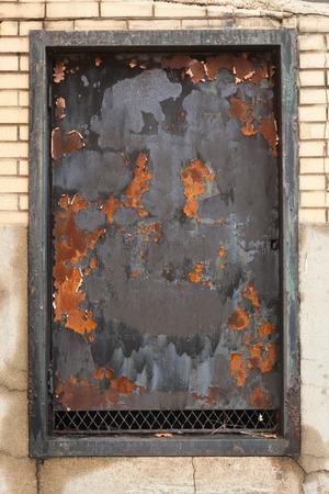 window shade: Rust on old iron window shade; vertical image