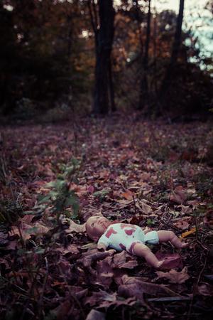 woodland  horror: Abandoned creepy doll in woods