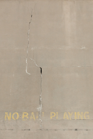 suspense: No ball playing painted on concrete wall