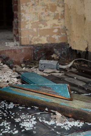 Broken glass and debris in deserted building