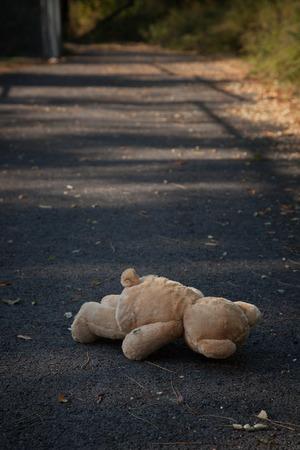woodland  horror: Abandoned teddy bear on path