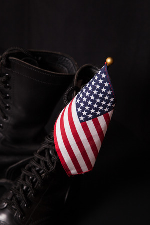 combat boots: A pair of combat boots with a small American Flag. Stock Photo