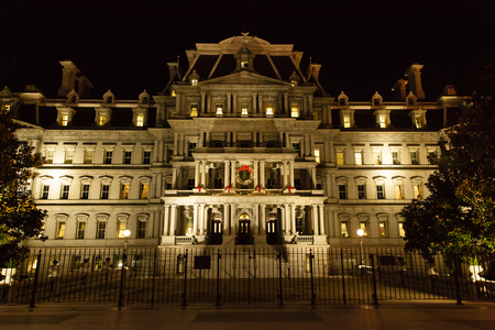eisenhower: Washington DC - December 5, 2015:  A view of the Eisenhower Executirve Office Building at night, decorated for Christmas
