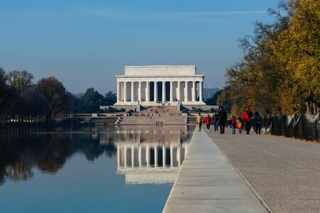 lincoln memorial: Washington DC - December 6, 2015:  The Lincoln Memorial is reflected in the reflection pool on a bright, sunny day