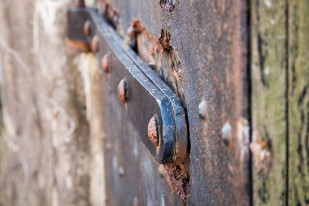 rivets: Rusted rivets on an old iron door Stock Photo