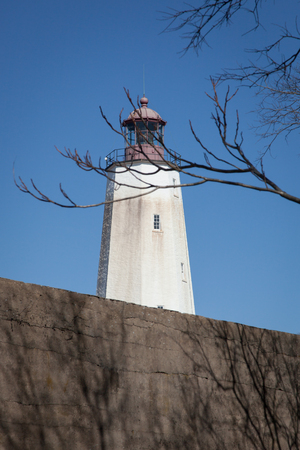 hancock: A view of the famous Sandy Hook Lighthouse at Fort Hancock in New Jersey. This is the oldest operating lighthouse in the United States. Photo taken on February 28, 2016.