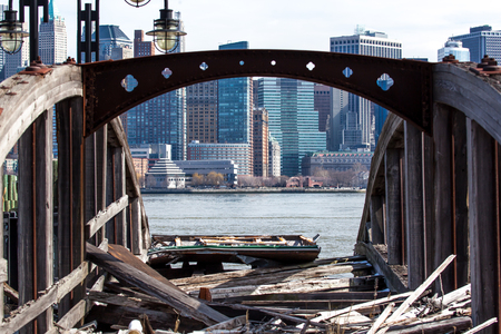 manhattans: A view of Lower Manhattans Financial District seen through the frame of an old ferry dock at Liberty State Park in New Jersey.