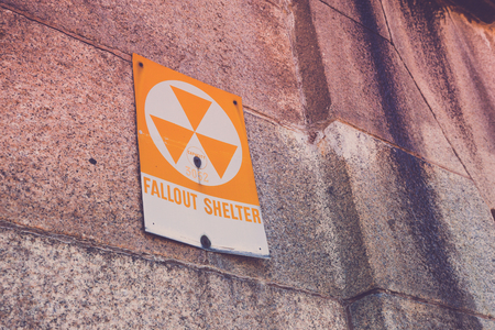 fallout: A old fallout shelter sign on the side of an old military fort.