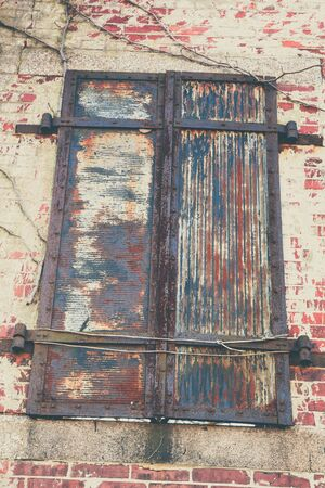 voyeur: Metal shutters, in a state of decay, at an old military fort.