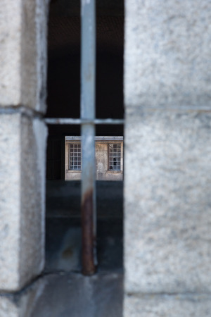 voyeur: A view through an old military fort window.  You can see clear through to the windows on the other side.