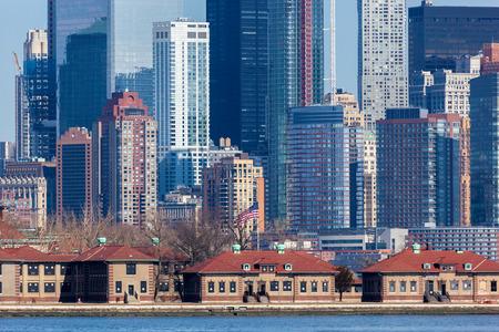 manhattans: A closeup of Lower Manhattans Financial District seen behind Ellis Island. Photo taken on March 6, 2016.