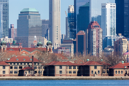 wtc: JERSEY CITY, NEW JERSEY - MARCH 6: A closeup of Lower Manhattans Financial District seen behind Ellis Island. Photo taken on March 6, 2016.