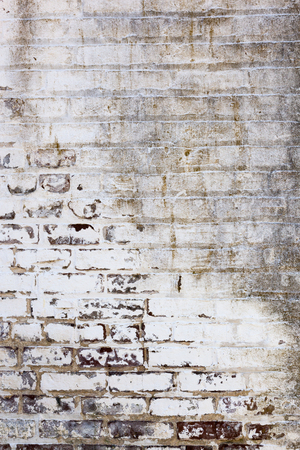 Details of old, weathered brickwork in a brick wall. Image would work as a background or wallpaper. Stock Photo