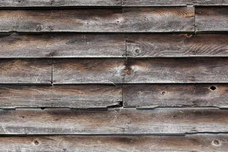 siding: Old, rustic wood siding on an old building, background Stock Photo