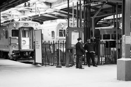 river county: APRIL 11, 2016 - Hoboken, NJ: Railroad conductors stand by the tracks at Hoboken Terminal