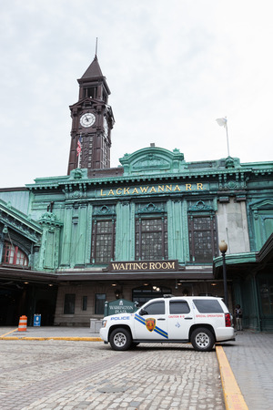 k9: APRIL 11, 2016 - Hoboken, NJ: A view of the exterior of Hoboken Terminal on an overcast day. A New Jersey Transit Police K-9 truck is parked outside. Editorial