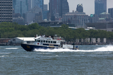 fleet: NEW YORK, NY - May 25, 2016: A New York Police Department boat patrols the Hudson River during the Parade of Ships, kicking off Fleet Week. Editorial