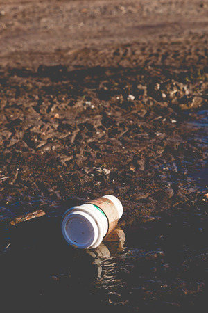 FORT LEE, NEW JERSEY - January 1, 2017: A Starbucks coffee cup litters the ground at Fort Lee Historic Park
