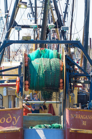 cody: BELFORD, NEW JERSEY - April 11, 2017: Fisherman work on the Cody fishing boat docked at the Belford Seafood Cooperative