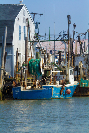 lyn: BELFORD, NEW JERSEY - April 11, 2017: Commercial fishing boats are docked at the Belford Seafood Cooperative Editorial