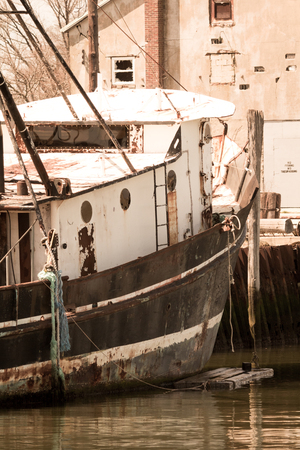 BELFORD, NEW JERSEY - April 11, 2017: An old fishing boat is docked at the Belford Seafood Cooperative