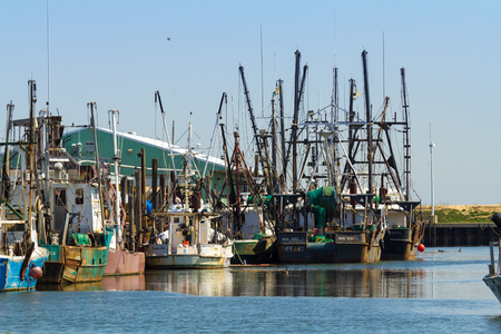 BELFORD, NEW JERSEY - April 11, 2017: Commercial fishing boats are docked at the Belford Seafood Cooperative Editorial