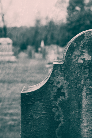 Old Tombstones are seen in a cemetery.