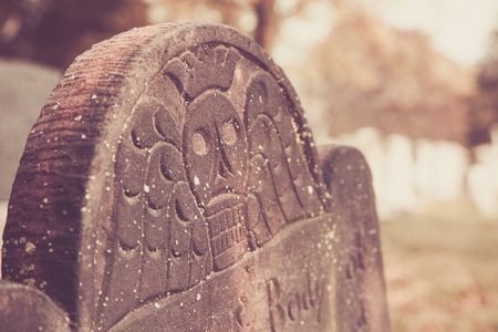 Details of a skull face on the top of a Revolutionary War era tombstone. Stock Photo