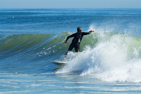 DEAL, NEW JERSEY - September 13, 2017: Surfers soak up the last bit of summer and enjoy the swells from Hurricane Jose