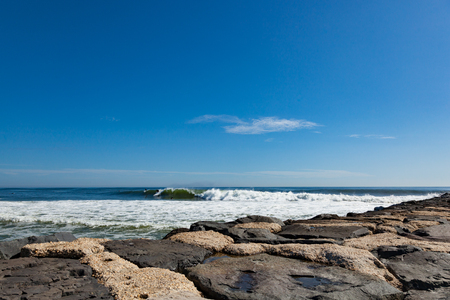 Surfers soak up the last bit of summer and enjoy the swells from Hurricane Jose