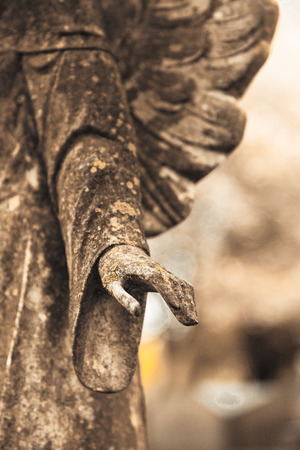 Details of the hand of a beautiful angel monument that marks a grave at Princeton Cemetery, owned by the Nassau Presbyterian Church. This photo was taken in April of 2017. Stock Photo