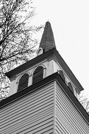 Details of an old church steeple in black and white.
