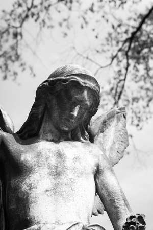 RAHWAY, NEW JERSEY - April 28, 2017: Details of an angel statue atop a grave at Rahway Cemetery Stock Photo