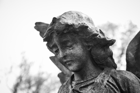 RAHWAY, NEW JERSEY - April 28, 2017: Details of an angel statue atop a grave at Rahway Cemetery Editorial
