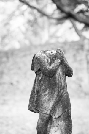 An old statue atop a grave has fallen apart at Rahway Cemetery Stock Photo