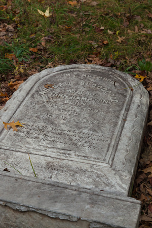 METUCHEN, NEW JERSEY - October 16, 2017: A view of Abigail Bloodgoods tombstone in the Metuchen Colonial Cemetery. The stone was knocked over by vandals in 2016.