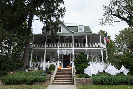 ATLANTIC HIGHLANDS, NEW JERSEY - September 30, 2017: An old house is decorated beautifully with spooky decorations in this coastal community
