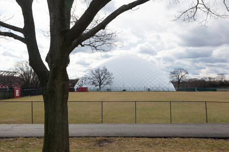 PISCATAWAY, NEW JERSEY - January 4, 2017: A view of the domed practice field at Rutgers University, Busch Campus