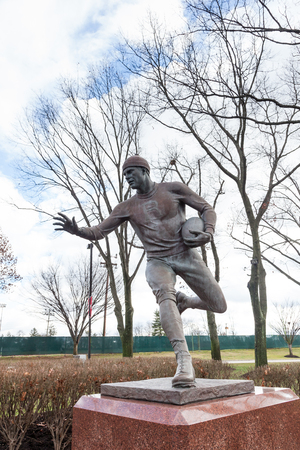 PISCATAWAY, NEW JERSEY - January 4, 2017: A view of the football player sculpture on the Scarlet Walk at Rutgers University Busch Campus Editorial
