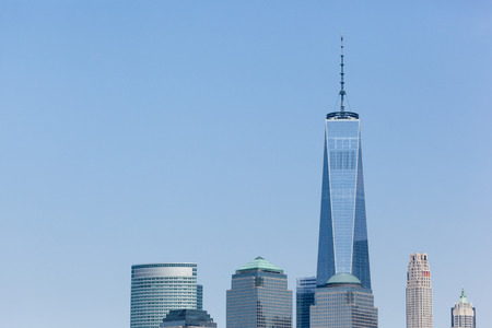 NEW YORK, NEW YORK - May 25, 2016: The top of the Freedom Tower and other World Trade Center Buildings are seen on a bright Spring day.