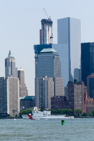 NEW YORK, NEW YORK - May 25, 2016: The US Coast Guard Cutter Forward sails the Hudson River during Fleet Weeks Parade of Ships.