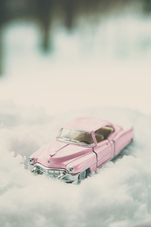 WOODBRIDGE, NEW JERSEY - March 14, 2017: A diecast toy Cadillac in the snow Editorial