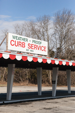 WALL TOWNSHIP, NEW JERSEY - March 20, 2017: The sign at the now closed Circus Drive-in indicates weather-proof curb service