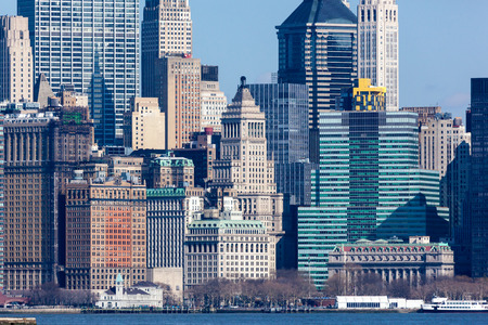 NEW YORK, NEW YORK - March 6, 2016: A beautiful view of the financial district from the Hudson River on a sunny day
